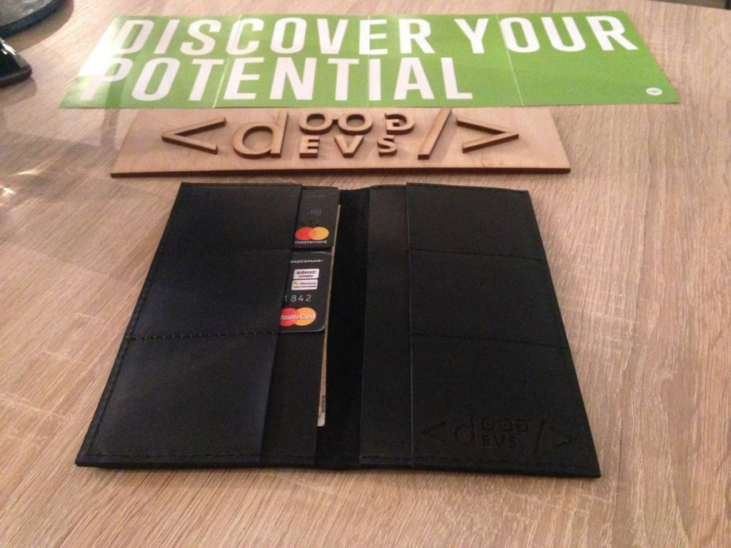 branded wallet and wooden sign